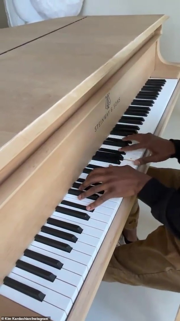Accompaniment: Kim panned her camera over to her lovely wood-grain Steinway piano, which was played by Kanye West's Sunday Service music director Philip Cornish