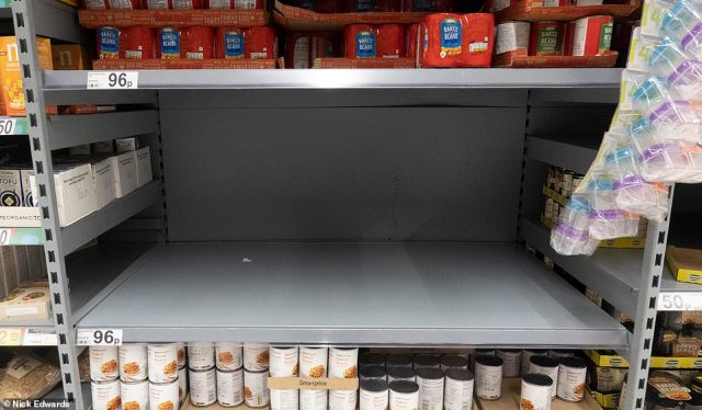 The shelves were emptied of certain canned goods at this Asda store on Old Kent Road, in south London, after the capital was plunged into Tier 4