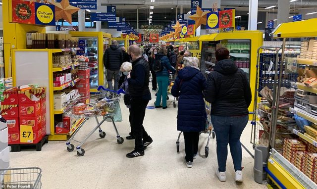Several supermarkets in Liverpool, Merseyside, are busy today, with shoppers pictured here in the city's Tesco store