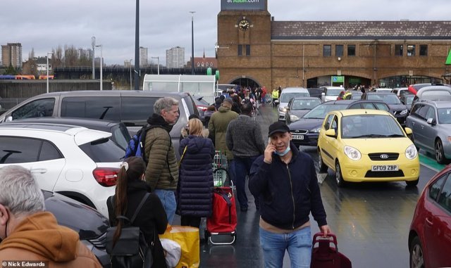 Long queues outside the Asda at Clapham Junction in South West London as people try to get Christmas shopping