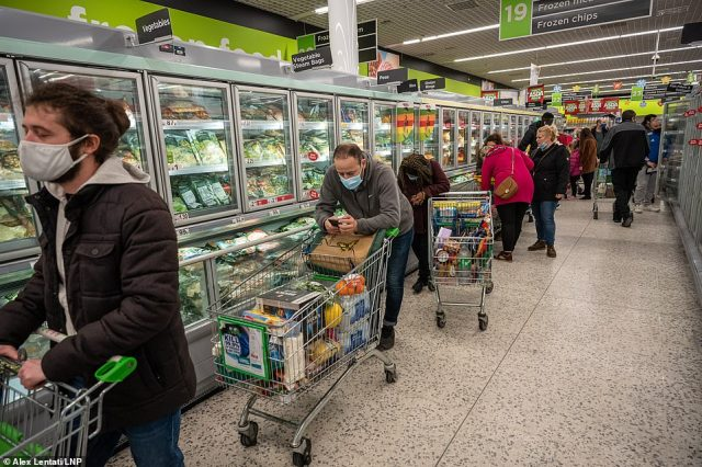 Chaotic scenes at Asda in Wandsworth, South West London as a huge rush of shoppers descended on the store causing long queues in the aisles. One man at the front of the queue appeared to be resting his eyes as he had been waiting so long
