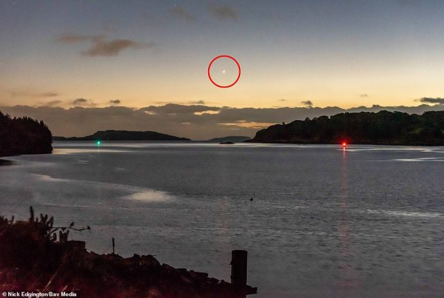 Jupiter and Saturn above Oban on the Sound of Kerrera,a waterway separating the island of Kerrera, Argyll and Bute, looking out towards the Western Islands in Scotland,December 21, 2020