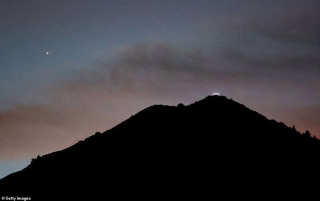 Jupiter (L) and Saturn appear about one-tenth of a degree apart. Pictured, the view above Mt. Tamalpais on December 21, 2020 in Larkspur, California