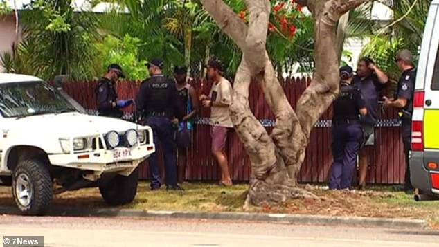 A five-year-old boy walked to help after finding his parents dead in their North Queensland home. Pictured: police at the scene