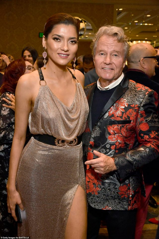 With her love: The star with beau John Savage at The BAFTA Los Angeles Tea Party at Four Seasons Hotel in January