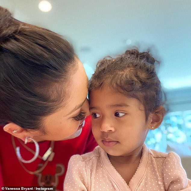 Aww: Bryant beamed with joy as she gazed at her adorable daughter