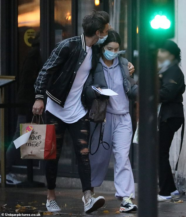 Loved up: New couple Maura Higgins and Chris Taylor were spotted stepping out in London on Monday, in their first public sighting since confirming their romance