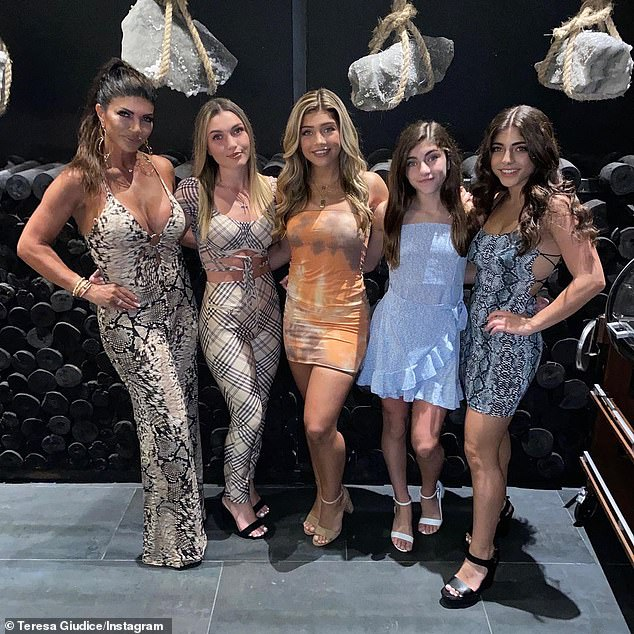 She has four mini mes: The star, far left, with her four daughters with ex Joe