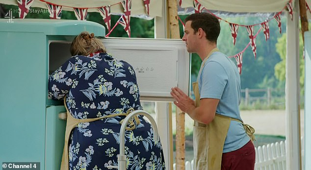 Upset:Fans of the show praised Laura after she got emotional over the signature bake when her eight custard slices failed to set, and she hid her head in the freezer as she cried