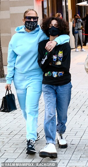 The 12-year-old, whom she shares with ex-husband Marc Anthony, wore baggy jeans and a black sweatshirt adorned with cartoon characters