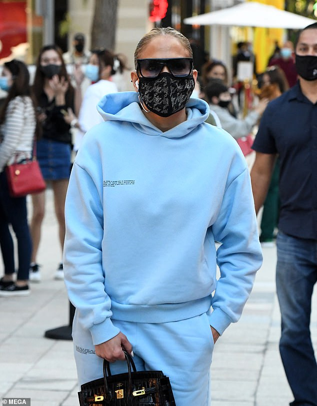 Got the (baby) blues? The singer-dancer-actress was bundled up in a baby blue tracksuit for the casual outing