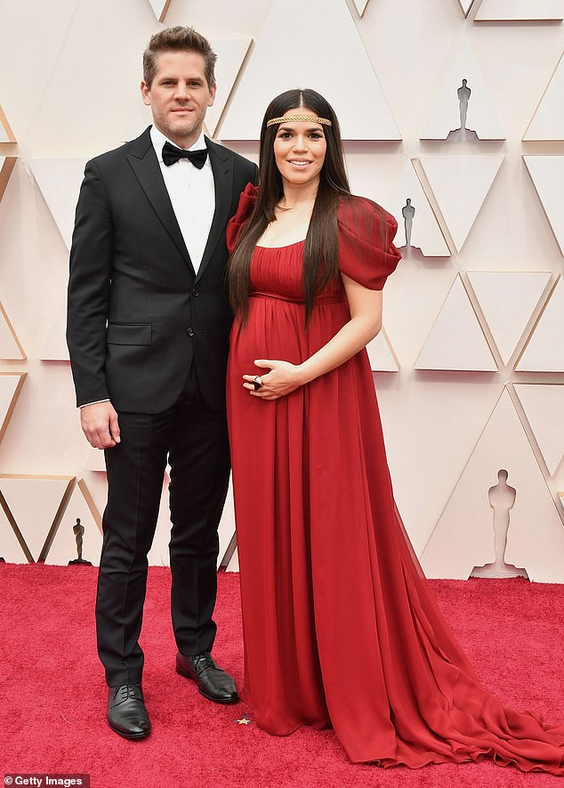 Working from home: America Ferrera opened up to People on Tuesday about how 'overwhelming' it has been to raise to young children while working from home ; seen with husband Ryan Piers Williams in February