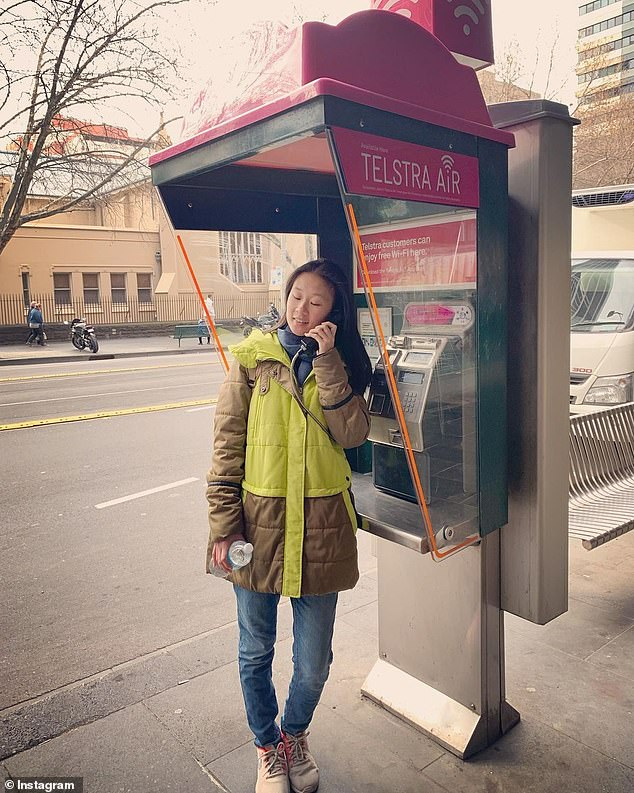 A woman with a Telstra payphone. Telstra will make all 15,000 of its payphones across the country free from Thursday until January 1