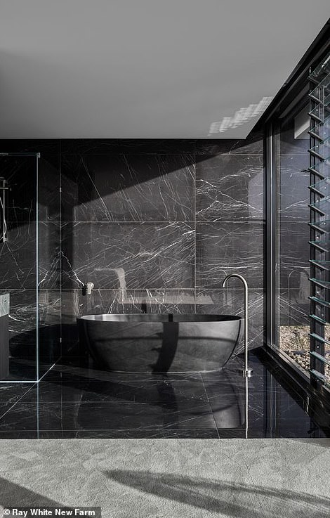 As well as eight bathrooms - the one has an amazing black tub