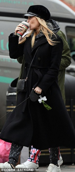 Looking lovely: The 35-year-old, who is due to give birth in the new year, displayed a hint of her bump underneath a belted black coat as she sipped on a hot drink