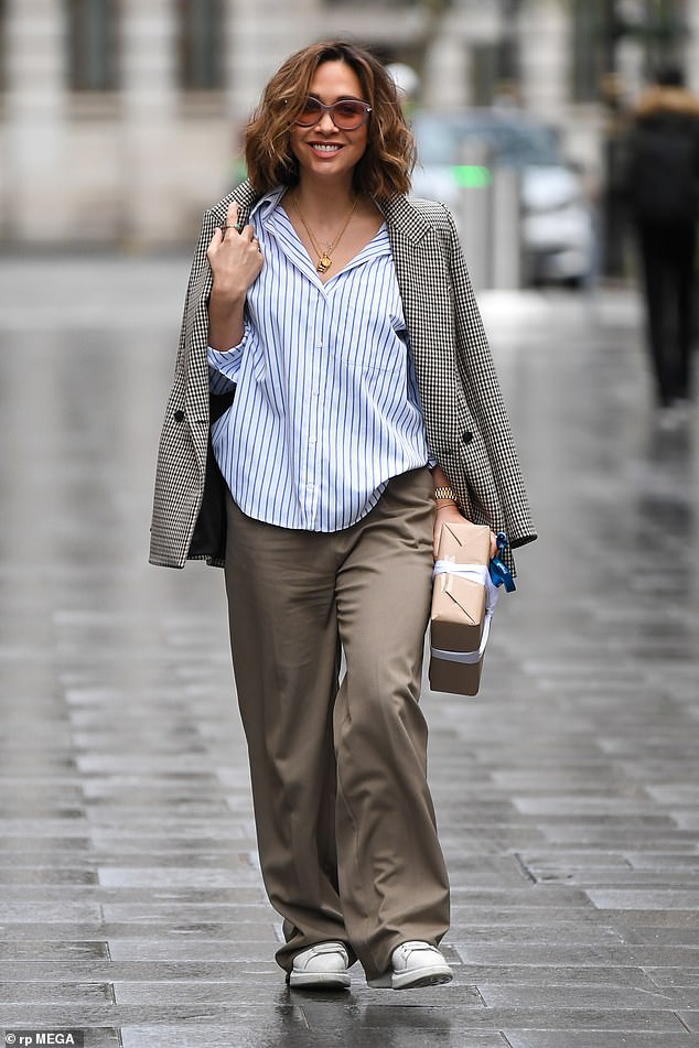 Happy: Myleene Klass was still smiling as she headed to work to present her Smooth Radio show at Global Studios on Wednesday, after rehearsals for Dancing On Ice had to be cancelled
