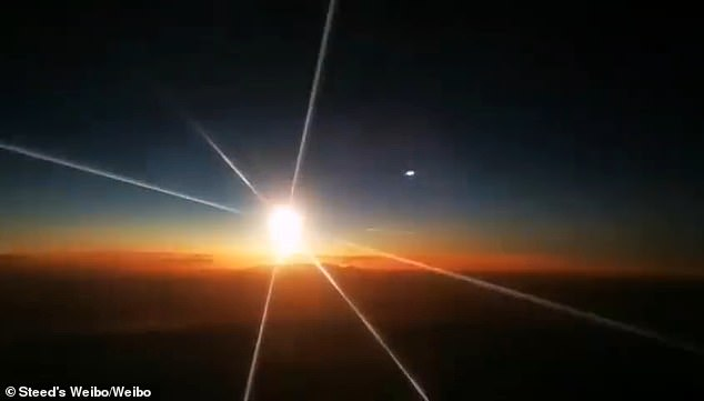 One of the videos, shared by a science blogger on Twitter-like Weibo, captures the moment the fireball soars through the darkness as it is seen by a passenger on a domestic flight