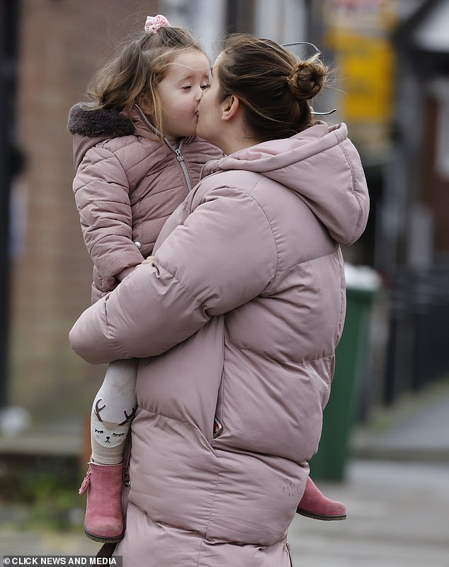 Sweet:The two enjoyed their spot of fresh air, with doting mum Jacqueline lifting her little girl into her arms for a kiss at one point