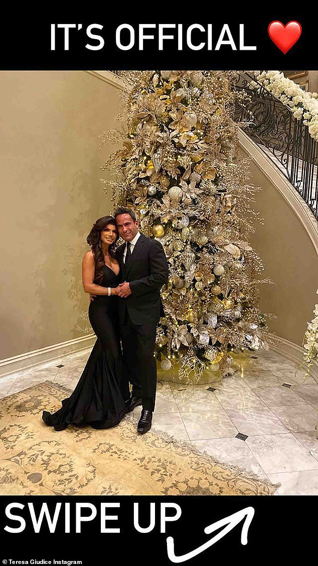 A big red heart:The beauty had on a low-cut black dress. The Bravo star added diamond jewelry. Her new man was dapper in a dark suit as he put an arm around his lady love and held her hand. In her caption she said, 'It's official'