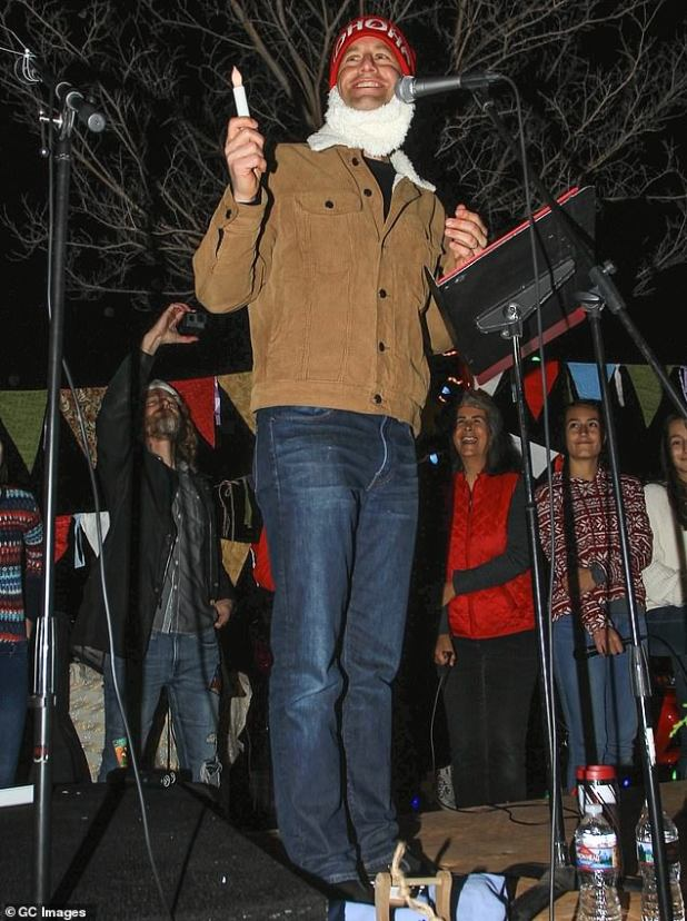 Cameron was blasted as 'growing pains' by another masked Christmas carol protest in California on Tuesday by the actor