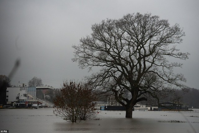 Floodwater covers the racecourse at Worcester yesterday after heavy rain in the area two days before Christmas