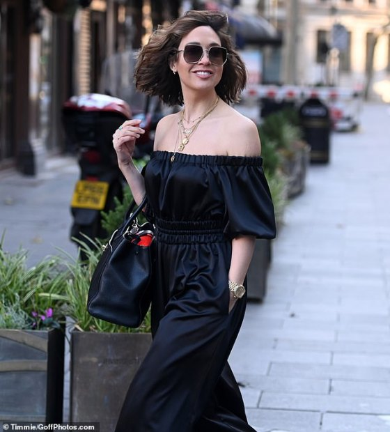 Present: The host (39) looked elegant in a black satin bandeau jumpsuit with pockets that was a Christmas present from friend Kate Halfpenny
