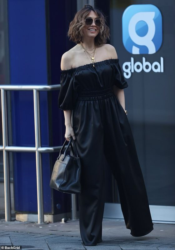 Approach: She added hexagonal sunglasses and layered gold necklaces, and wore a black shoulder bag