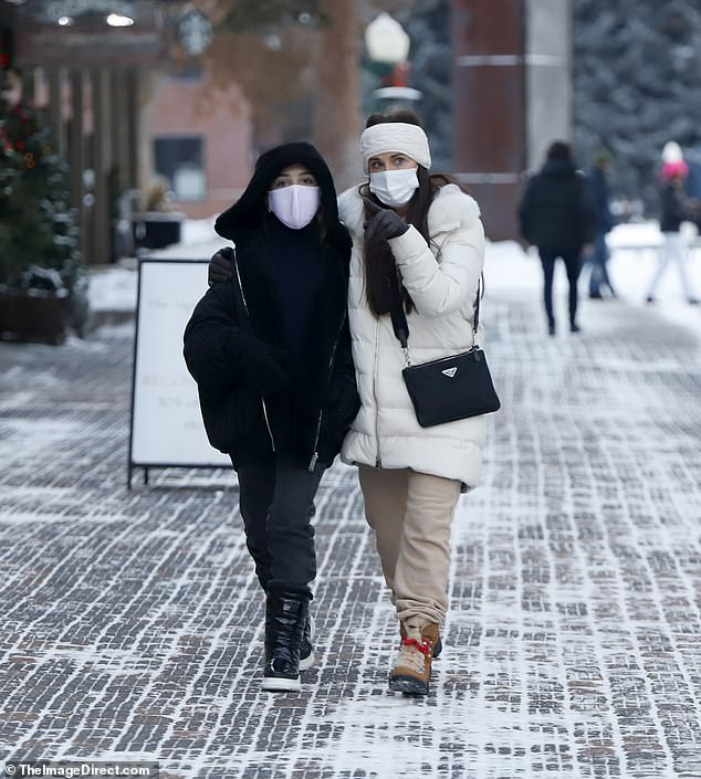 Luxe look:Kyle was dressed perfectly for the snowy getaway as she sported a white down coat featuring a fur-lined hood