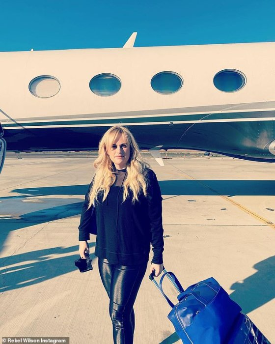 Traveling with style: She also added a few photos of the group posing in front of her private jet on the Aspen runway