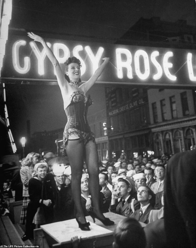 Gypsy Rose Lee was already the world's most famous stripper when she  joined the Royal American Carnival Shows in 1949.  Born to an ambitious 'stage mother from hell', Gypsy spent her entire youth on the road performing in vaudeville as a child actor. She made her debut on the burlesque stage when she was 15-years-old at the behest of her mother. Above, Lee performs her traveling striptease act to a captivated audience on the opening day of the Memphis Cotton Carnival in May 1949