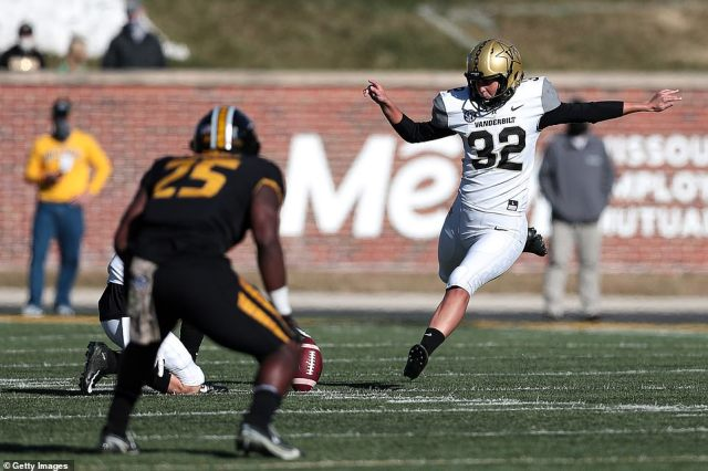 In this handout image provided by Mizzou Athletics, Sarah Fuller No. 32 of the Vanderbilt Commodores kicks off in the second half against the Mizzou Tigers at Memorial Stadium on November 28, 2020 in Columbia, Missouri. Fuller, a senior goalkeeper on Vanderbilt's SEC championship soccer team became the first woman to play in a Power 5 NCAA football game
