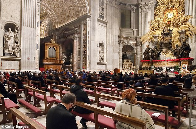Fewer than 200 people, wearing face coverings, attended the mass, and they were mostly employees of the tiny state of Vatican City (pictured)