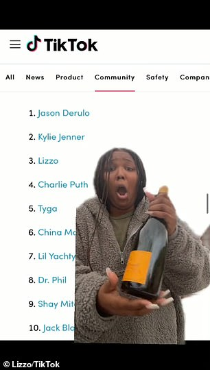 Clutching a bottle of champagne, Lizzo gushed: '[First] I gotta thank YOU!'