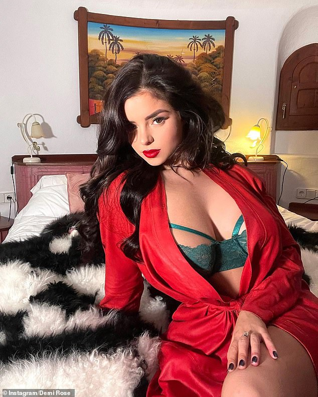 Eye-popping:The glamour model, 25, sent pulses racing as she put on a busty display in a skimpy green lingerie set, which she paired with a festive red latex-look jacket