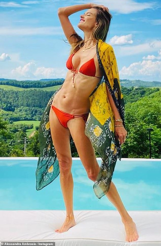 Christmas bikini: Alessandra Ambrosio put her toned figure on display Friday in a red bikini, as she spent Christmas Day by the pool with her family in her tropical home state of Rio Grande do Sul, Brazil