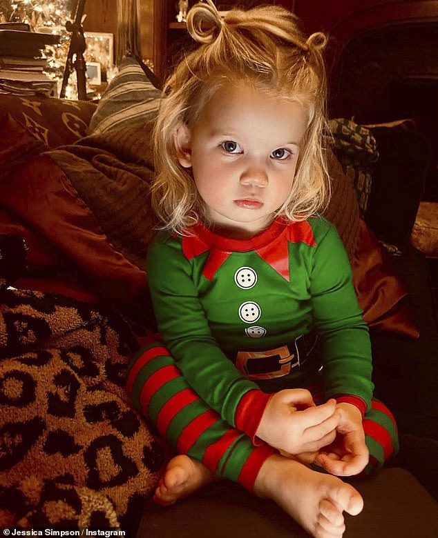 'Our little elf'The media personality also posted an adorable picture of their youngest, Birdie, 21 months, in an elf costume with her hair in pig tails