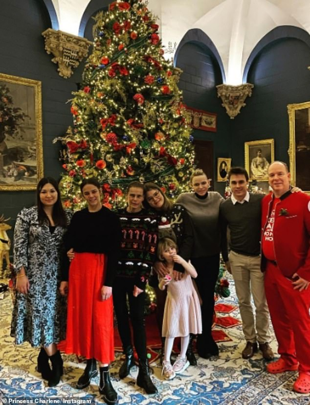 Princess Charlene of Monaco previously posted a Christmas photo with her husband Prince Albert in an apparent show of unity after it emerged he will appear in court in the new year to fight explosive claims he fathered a third love child with a secret girlfriend. Pictured left to right: Marie Ducruet, Pauline Ducruet, Princess Stephanie, Camille Ducruet, Princess Gabriella, Princess Charlene, Louis Ducuret and Prince Albert II