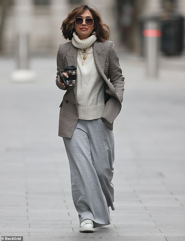 Comfort: The presenter, 39, opted for comfort in grey jogging bottoms with an elasticated waist after the Christmas festivities
