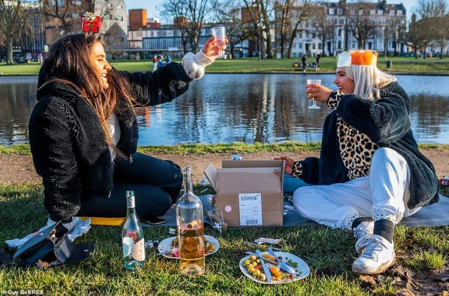 Photographs showed groups meeting to eat their Christmas dinners on Clapham Common in London on Christmas Day as the city is in Tier 4