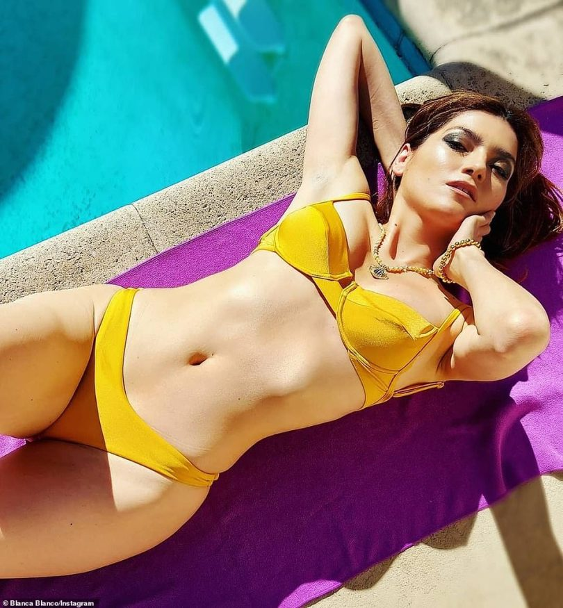 Bathing beauty:Blanca Blanco was happy to get some sun after spending Christmas morning with her boyfriend of over a decade, Deer Hunter star John Savage. The brunette bombshell looked curvy in a bright yellow bikini that made the most of her curves as she got a suntan by her swimming pool