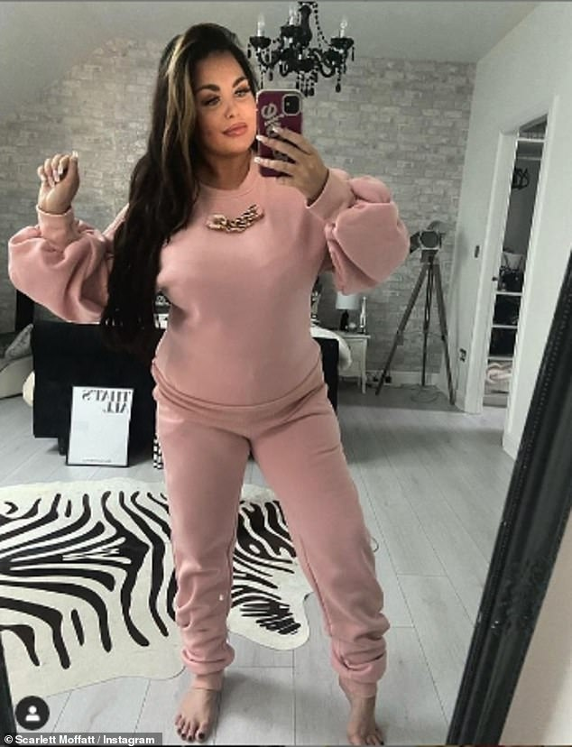 'Enhanced curves': Scarlett joked about putting on weight over lockdown 2.0 as she posed in a pink tracksuit on Instagram on Monday