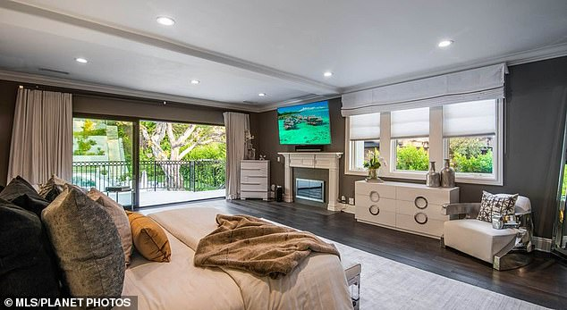 His loss, her gain: While living at the six-bedroom, eight-bathroom pad he added a number of 'Vegas-like custom upgrades,' which did not help him return on investment