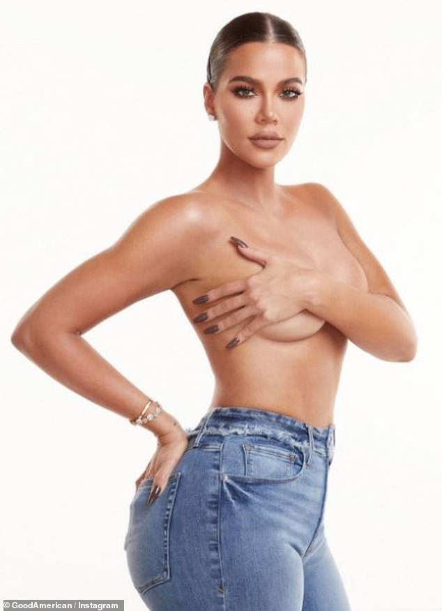 Showing skin: Khloé Kardashian put her signature curves on full display Saturday, as she went topless while modeling a pair of skintight Good American jeans, posting the sizzling photo to the brand's Instagram