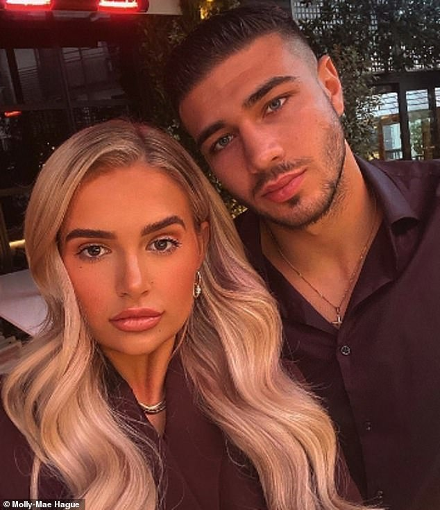 Smitten: They met on the 2019 series of Love Island and Tommy Fury proved love is still in the air as he gifted his girlfriend Molly-Mae Hague, a £3,210 Chanel handbag for Christmas
