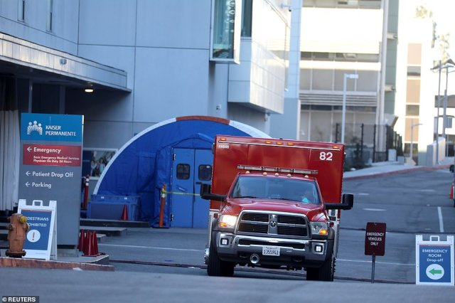 An ambulance crew leaves Kaiser Peminente Hospital emergency room during a surge of coronavirus cases in Los Angeles on Saturday