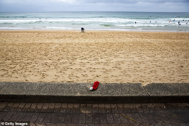 Gladys Berejiklian announced 24,000 people had been tested in the past 24 hours as the Northern Beaches cluster grew (pictured, an empty Manly beach on Christmas Day)