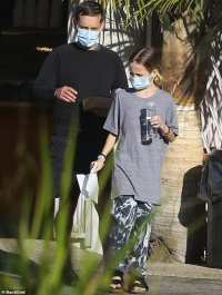 Tobey Maguire and son Otis, 11, make sure to keep their masks on as they step out for takeaway in LA