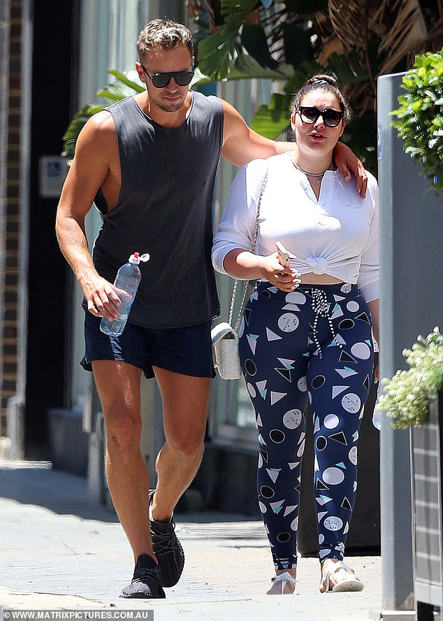 Sweet: The pair packed on the PDA, with Adam swinging his arm over Francesca's shoulder as they walked to her Aston Martin to head home together