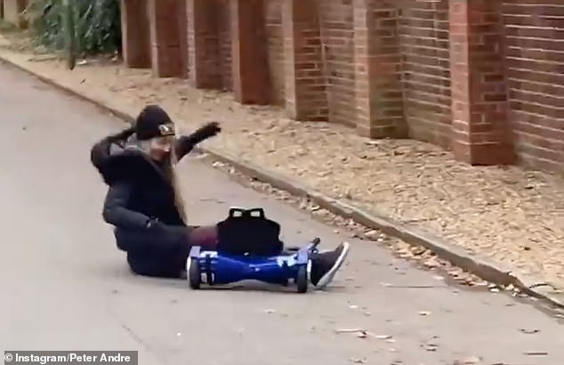 Playful: Emily screamed playfully as she rolled down the hill outside their home in Sussex, before the scooter veered towards the pavement and she toppled off