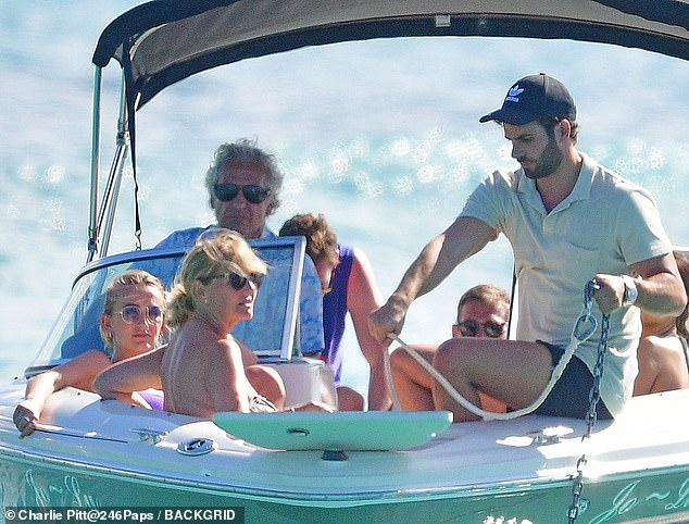 Chilled: Tiffany looked gorgeous in a purple bikini as she relaxed on a boat
